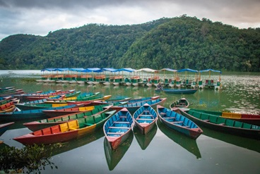 Colourful canoes on a lake