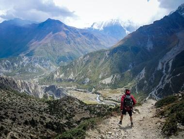 Someone overlooking a mountain trek